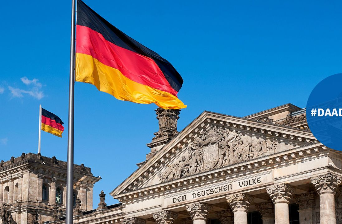 Reichstag with two German flags