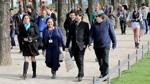 Two men and two women walking on the Uni campus - Alumni Special Projects