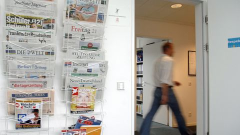 Newspaper hanging at a wall - Newsletter DAAD Aktuell