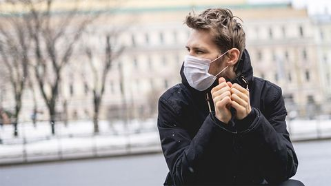 Young man with breathing mask - Coronavirus