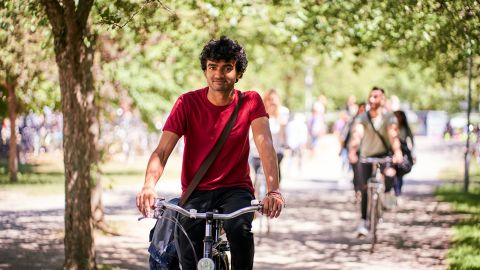 Student on a bicycle - Health insurance