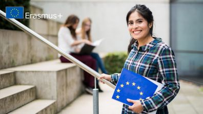 A young woman smiles at the camera  - EU Higher Education Cooperation